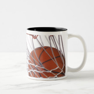 Basketball going through hoop Two-Tone coffee mug