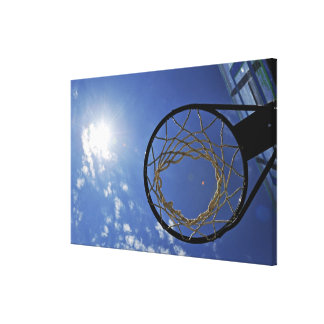 Basketball Hoop and the Sun, against blue sky Canvas Print