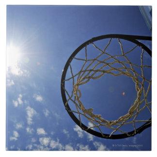 Basketball Hoop and the Sun, against blue sky Tile