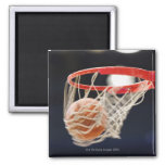 Basketball in basket. 2 inch square magnet