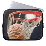 Basketball in basket. laptop computer sleeves