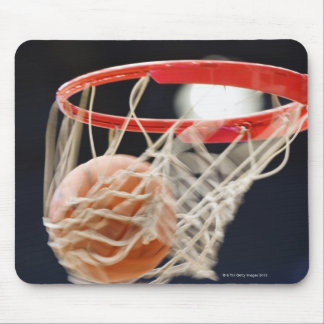 Basketball in basket. mouse pad