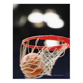 Basketball in basket. post card