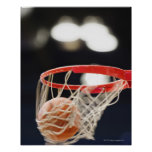 Basketball in basket. posters