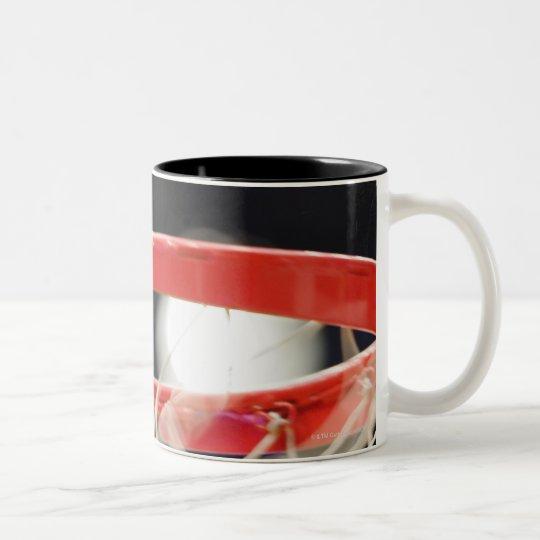 Basketball in basket. Two-Tone coffee mug