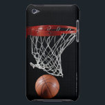 "Basketball in Hoop Barely There iPod Cover<br><div class=""desc"">AssetID: AA038144 / {Ryan McVay} / Basketball in Hoop _x000D_ _x000D_ Basketball is a team sport , the objective being to shoot a ball through a basket horizontally positioned to score points while following a set of rules . Usually, two teams of five players play on a marked rectangular court...</div>"