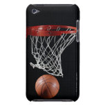 Basketball in Hoop Barely There iPod Cover<br><div class='desc'>AssetID: AA038144 / {Ryan McVay} / Basketball in Hoop _x000D_ _x000D_ Basketball is a team sport , the objective being to shoot a ball through a basket horizontally positioned to score points while following a set of rules . Usually, two teams of five players play on a marked rectangular court...</div>