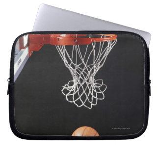 Basketball in hoop, close-up 2 computer sleeve