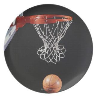 Basketball in hoop, close-up 2 dinner plate