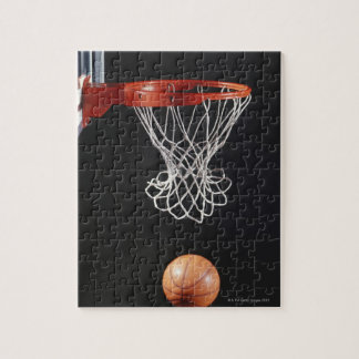 Basketball in hoop, close-up 2 jigsaw puzzle