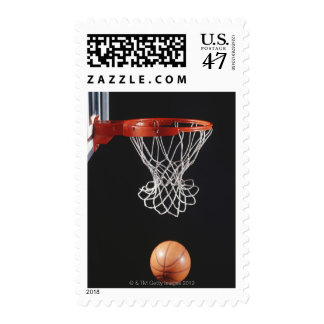 Basketball in hoop, close-up 2 postage