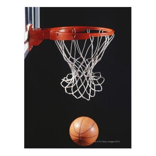 Basketball in hoop, close-up 2 postcard