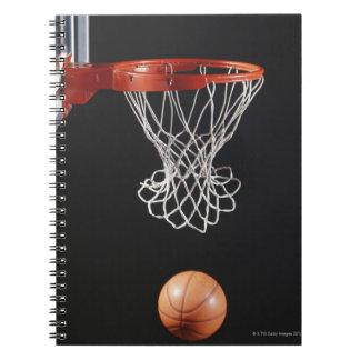 Basketball in hoop, close-up 2 spiral notebook