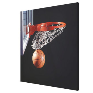 Basketball in hoop, close-up canvas print
