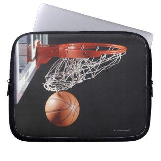 Basketball in hoop, close-up computer sleeve