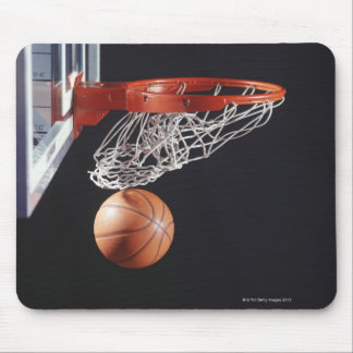 Basketball in hoop, close-up mouse pad