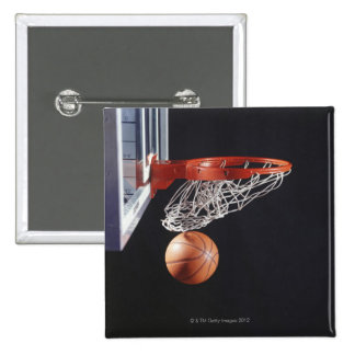 Basketball in hoop, close-up pinback button