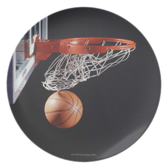 Basketball in hoop, close-up plate