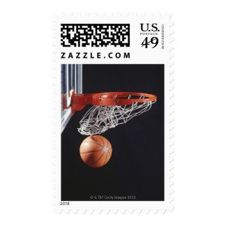 Basketball in hoop, close-up postage stamps