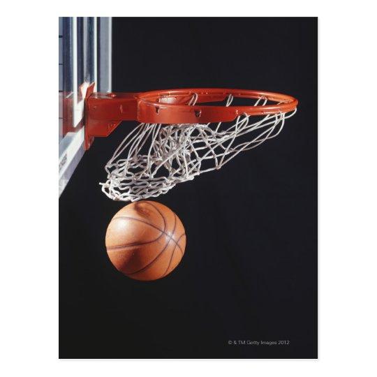 Basketball in hoop, close-up postcard