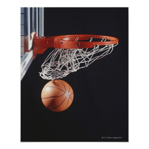 Basketball in hoop, close-up posters