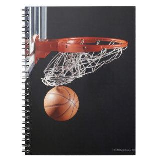 Basketball in hoop, close-up spiral notebook