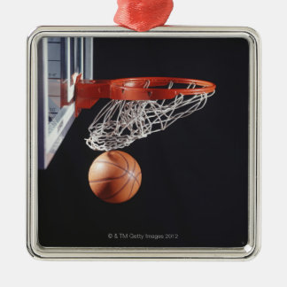 Basketball in hoop, close-up square metal christmas ornament