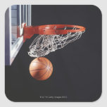 Basketball in hoop, close-up square sticker