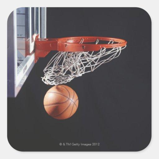 Basketball in hoop, close-up sticker