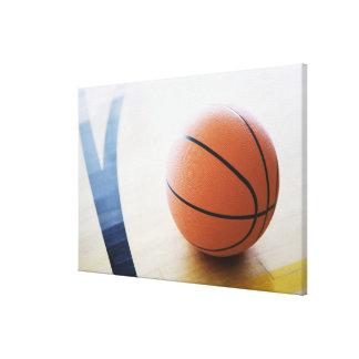 Basketball on court canvas print