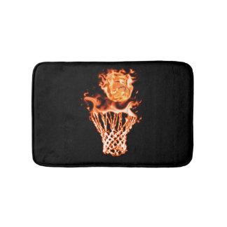 Basketball on fire going through the fire net bath mat