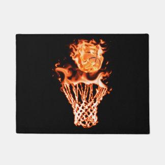 Basketball on fire going through the fire net doormat