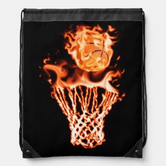 Basketball on fire going through the fire net drawstring bag