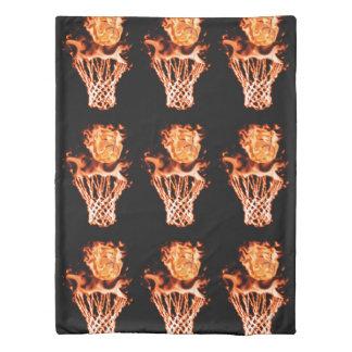 Basketball on fire going through the fire net duvet cover