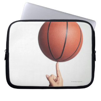 Basketball on index finger,hands close-up laptop sleeve