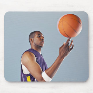 Basketball player balancing ball on one finger mouse pad