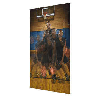 Basketball player dribbling ball on court canvas print