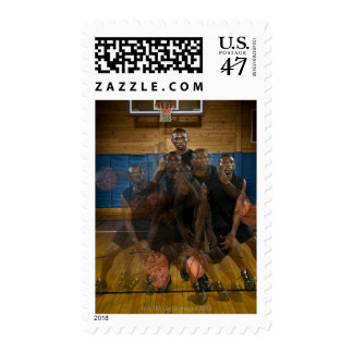Basketball player dribbling ball on court postage