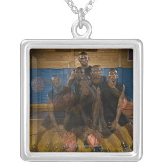 Basketball player dribbling ball on court silver plated necklace