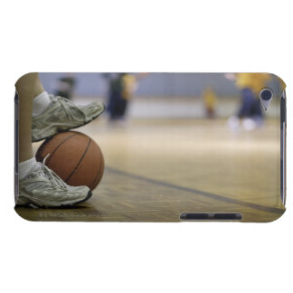 Basketball player holding ball with feet iPod touch cases