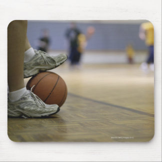 Basketball player holding ball with feet mouse pad