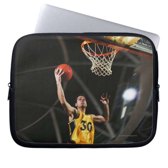 Basketball player  jumping in air computer sleeve