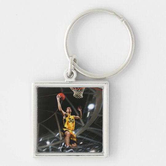 Basketball player  jumping in air keychain