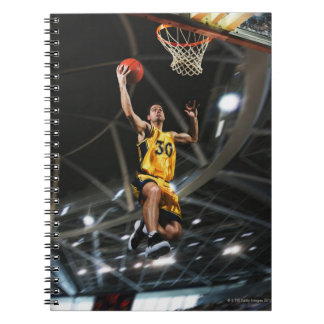 Basketball player  jumping in air notebook