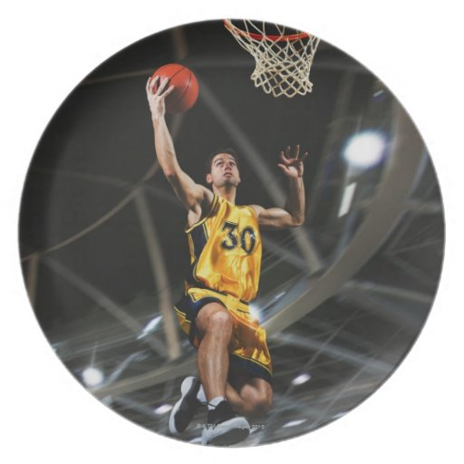 Basketball player  jumping in air plate
