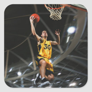 Basketball player  jumping in air square sticker