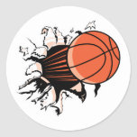 basketball ripping through round stickers