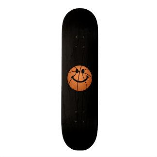 Basketball smiley face skateboard deck