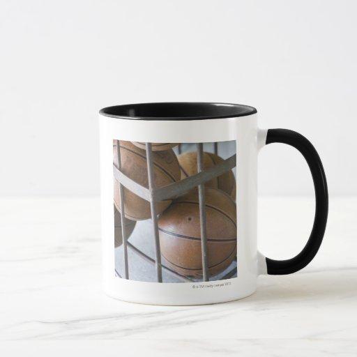 Basketballs in a basket mug