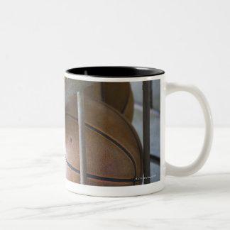 Basketballs in a basket Two-Tone coffee mug